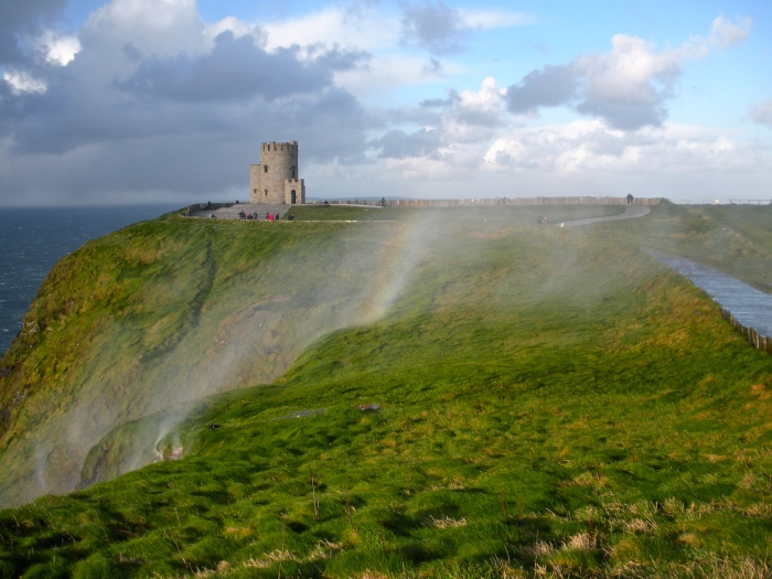 """A view of O'Brien's Tower in the background of the """"reverse"""" waterfall and rainbow."""