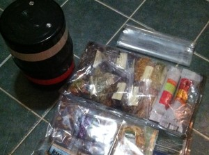 Prepping before our trip. Our bear canister and food in odor-proof bags.